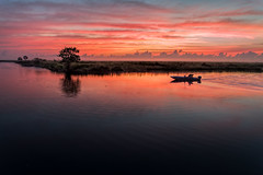 Let's go fishing! (Ed Rosack) Tags: sky orange usa cloud reflection tree reed water weather sunrise river landscape dawn boat fishing florida cloudy explore swamp boating marsh cocoa centralflorida rivergrass edrosack