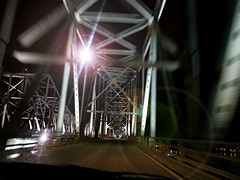 Fleeing Mississippi at Midnight (Studio d'Xavier) Tags: phobias fears mississippiriverbridge fleeingmississippiatmidnight werehere placesrevisited cameraphonepictures gephyrophobia fearofbridges yeahifear bridgesmy wife was drivingwhile i snappeda series picsleaving mississippithis one wasthe best explored bridge