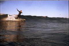 Dancers (c_kreature) Tags: ocean california ca waves surfing newportbeach pacificocean 35mmfilm 200 surfers fujifilm orangecounty westcoast theoc waterproof 35mmphotography fujicolor filmphotography norrinradd newportbeachpier nikonosiii waterphotography surfingphotography fujifilmfujicolor200 surferphotos blackiesbeach nikonosproject hurricanemarie