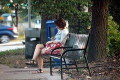 The fading days of summer. (kennethkonica) Tags: summer people usa men public america bench fun outdoors reading nikon women day sitting cops indianapolis seat smiles indy police indiana nikond70s parade busstop sit waving seated groups hoosiers cellphones marioncounty themiraclemile perrytownship mayorgregballard southsideindianapolis