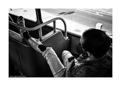 tennis knee (jrockar) Tags: street city light shadow people urban blackandwhite bw man bus guy london contrast 35mm lens photography prime mono support fuji ride shot candid injury streetphotography documentary rangefinder snap human instant moment knee decisive ordinarymadness x100s