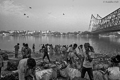 The Calcutta commotion (debriddhi) Tags: morning travel people blackandwhite india canon photography photo asia cityscape chaos photos calcutta urbanscape commotion lpchaotic