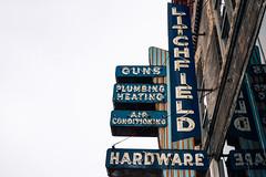 Guns & Hardware (hartsaw) Tags: litchfieldhardware rantoul illinois guns neon sign signage vintage retro americana hardwarestore a5000 rural reflection