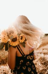 Ecco.. (Jeღ) Tags: sun sunset sunsetlight surrealphotography sunflowers flowers flowersfield light nature girl blondie canon 35mm hair naturalillumination bokeh