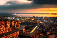 Thessaloniki Sunset (NicoTrinkhaus) Tags: thessaloniki saloniki greece griechenland hellas night nightscape nightphotography lighttrails sunset view sky clouds citywall macedoniagreece makedonia