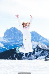 Joy (Nicola Pezzoli) Tags: nature snow winter val gardena italy tourism colors dolomites dolomiti mountain santa cristina ortisei gröden alto adige seceda sofie hutte baita jump girl sassolungo