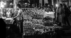 Two Ends (relishedmonkey) Tags: nikon d5300 35mm 18g fruits cooking food living jobs ends job lighting black white monochrome outside city ernakulam kerala street life shade shadows bulbs night urban people man men