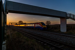 Meridian reflections (Peter Leigh50) Tags: kilby bridge junction meridian east midland trains footbridge sky sunset railway train