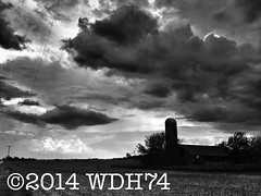 Silhouette (William 74) Tags: shadow sky blackandwhite bw building abandoned silhouette clouds barn rural silo