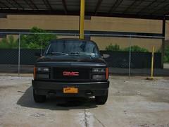1993 GMC YUKON GT (richie 59) Tags: auto summer usa ny newyork america truck fence outside four us parkinglot automobile gm unitedstates 4x4 headlights grill yukon vehicle newyorkstate suv oldtruck gmc nys 4wheeldrive ulster nystate gmctruck frontend generalmotors hudsonvalley 2014 2door ulstercounty twodoor motorvehicle americantruck midhudsonvalley blacksuv ulstercountyny techcity gmtruck oldsuv gmcyukon oldgmc gmcsuv ustruck wheeldrive gmc4x4 ulsterny 2010s americansuv gmsuv yukongt townofulster richie59 1990strucks townofulsterny twodoorsuv 2doorsuv 1990ssuv ussuv summer2014 june2014 june202014 gmcyucongt chainlinkfencegmc 1993yukon 1993gmcyukongt blacsuv