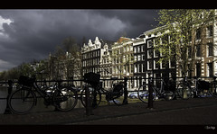 Dark clouds in Amsterdam (zilverbat.) Tags: world city wallpaper dutch amsterdam weather bicycle architecture clouds buildings lights europa europe shadows postcard gevels nederland thenetherlands d
