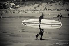 Seasoned Surfer (mspbusy) Tags: summer beach blackwhite surfer newquay surfboard carry fistralbeach ageism