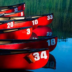 Numbers.jpg (docoverachiever) Tags: red lake canada reflection boats colorful numbers canoes alberta lakelouise multicolor banffnationalpark flickrchallengegroup flickrchallengewinner beginnerdigitalphotographychallengewinner squareratio