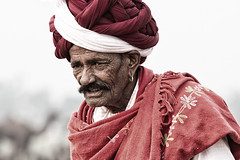 camel trader at Pushkar, India (BDphoto1) Tags: portrait india color face horizontal scarf one indian traditional streetphotography editorial turban ethnic pushkar cultural rajasthan wrinkled