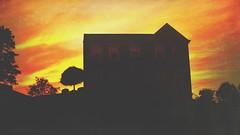 IMG_1436.JPG (Jamie Smed) Tags: sky hill silhouette sunset dark summertime home a200 jamiesmed snapseed sony vignette yellow beautiful skies trees house 2009 handyphoto light clouds orange mextures iphoneedit autostitch app alpha sun tree geotagged geotag facebook landscape dslr summer cincinnati