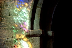 Rainbow lights inside the church (Tony Worrall Foto) Tags: england color history church wall lights rainbow arch colours shine place interior north stainedglass visit location northumberland inside lit colourful past northeast bamburgh shining shimmer 2014tonyworrall