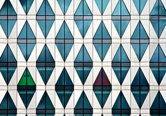 Concentration (moggsterb) Tags: city windows urban architecture chair pattern geometry angles panes repetition modernlife mundane offices linear shaded gird