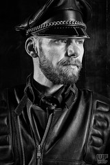 Tom in Black Leather (WF portraits) Tags: aut male model man onlocation black leather gayleather blackandwhite cap gaybeard beard