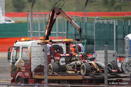 Pastor Maldonado's Lotus returns to the pits after qualifying for the 2014 British Grand Prix