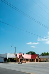 Historic Route 66 - Phillips Service Station at Baxter Springs, Kansas (MikePScott) Tags: road street camera usa sign buildings logo lens highway streetlight boulevard unitedstates motorway streetlamp flag garage phillips banner gasstation lamppost freeway kansas avenue servicestation petrolstation builtenvironment cherokeecounty architecturalfeatures historicroute66 baxtersprings nikond800 nikon28300mmf3556 featureslandmarks