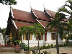 Elegant building of a wat in the Wat Sri Suphan complex (oldandsolo) Tags: thailand southeastasia buddhism chiangmai wat highstreet buddhisttemple norththailand buddhistshrine buddhistreligion watsrisuphan chiangmaistreet buddhistfaith silverubosot chiangmaitraffic downtownchiangmai