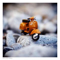 Beach Vespa (peterphotographic) Tags: italy orange beach square toy italia vespa dof bokeh scooter olympus depthoffield pebble microfourthirds olympusepl5 epl5 p7110398cb2candyedsqwm
