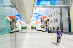 Broken symmetry (Nachett) Tags: street blue reflection bike bicycle azul germany deutschland calle bicicleta symmetry reflejo ciclista bici alemania biker ulm badenwrttemberg simetra
