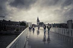 Liege Under The Rain (Gilderic Photography) Tags: street city bridge sky people urban man reflection rain architecture clouds lumix poste europe post belgium belgique belgie pluie panasonic ciel pont nuages rue liege ville passerelle gilderic lx3 dmclx3