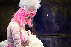 Pink against stone (elizunseelie) Tags: street city pink flowers roses portrait woman white floral girl smile hat festival stone female scotland edinburgh princess theatre pentax feminine vibrant capital performance bob scottish fringe ps lila fabric wig royalmile masquerade express busker drama netting oldtown edinburghfestival enigmatic k5 angelique ipad pixlr snapseed