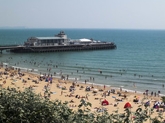 sunny bournemouth [explored] (carol_malky) Tags: sea holiday hot beach water pier day sunny busy isleofwight dorset bournemouth sunbathing lotsofpeople coolingdown explored viewfromclifftop