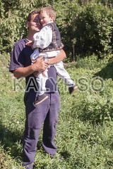 Happy Romanian Peasant Child Held In The Arms Of His Father (kalypsoworldphotography) Tags: family boy summer two portrait man male green art love smile grass proud rural vintage daddy happy countryside costume hugging holding dad village child looking adult affection outdoor folk traditional father country young culture son folklore parent national romania cuddle transylvania ethnic regional romanian caucasian embracing ardeal