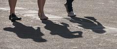 Shadowed tourists (kimbenson45) Tags: road people feet walking shoes shadows pavement
