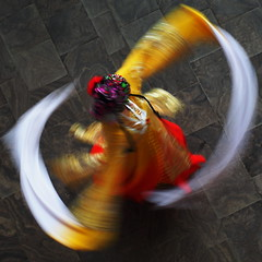 Chinese Dance (creditflats) Tags: mississauga livingartscentre lac mlac dance chinese china swirl colour color round motion pen ep5 olympus zeiss 50mm f17 legacy alternate blur planar dress scarf sleeves ontario canada spin mft microfourthirds yellow red