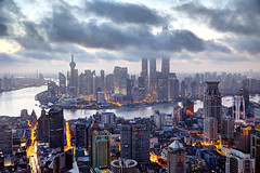 Into the clouds (Tony Shi Photos) Tags: china city morning urban tower skyline modern sunrise landscape downtown skyscrapers shanghai cloudy chinese perspective aerial financialdistrict highrise   gotham pudong    jinmao futuristic populated puxi  lujiazui  swfc huangpuriver  orientalpearltvtower    runrise   shanghaitower highangleview  huangpudistrict