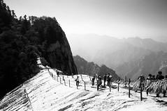 (JC.Murphy) Tags: china street camp bw cliff white mountain black film zeiss fence walk 28mm rangefinder adventure ridge xian ledge summit ikon range shaanxi orangefilter huashan  fomapan qinling dragonsridge