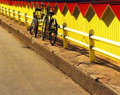 Il posteggio (meghimeg) Tags: red rot bike yellow parking hut gelb giallo rosso posteggio cabine 2014 biciclette bordighera encarnado