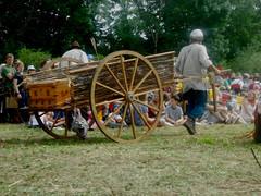 Man and his Barrow.jpeg (ShannonAllcock14) Tags: man green grass hat festival wooden big wheels medieval cloth wicker barrow tewkesbury
