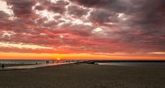 Sunset @ Oostende (Ivo Kreber) Tags: sunset sea sky orange sun beach night clouds strand canon dark gold grey zonsondergang sand warm horizon zee romantic avond 1740mm oranje goud eos550d