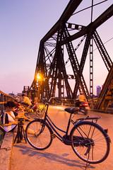 Long Bien Bridge (Jesse4870) Tags: old bridge sunset red people bike bicycle night river asia long dusk south east vietnam motorbike hanoi bien