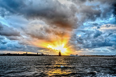 Sunburst (Dave McGlinchey) Tags: uk sunset sky sun weather clouds liverpool docks star solar nikon skies cloudy atmosphere sunburst waterdroplets atmospheric mersey icecrystals cloudscapes optic merseyside dockside rivermersey d7100 nikonafsdxzoomnikkor1855mmf3556gedii cloudsstormssunsetssunrises