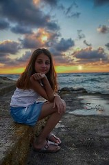 My sunshine (Sulafa) Tags: sunset sea summer portrait cloud sun girl clouds blueeyes niece blonde seashore sham blondegirl