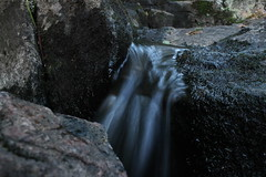 Water On The Rocks. (|SNAPShots| by: Patrick J.Whitfield) Tags: camera longexposure trees summer sky plants sun mist lake ontario canada mountains macro green slr nature wet water beautiful grass clouds creek canon river garden outdoors photography eos rebel landscapes waterfall moss spring woods backyard scenery rocks village mud quebec hiking path wildlife exploring ottawa peaceful lookout creepy hills adventure growth trail dew valley swamp views gatineau marsh benches forests mothernature breathtaking middleofnowhere upcloseandpersonal t3i greatescape onewithnature clearbluesky gettindirty iphone5 follow4follow like4like lazyshutter