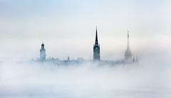 City in the Sky III (Hannes R) Tags: city morning sky cloud mist tower church fog skyline clouds dawn town sweden stockholm towers churches gamlastan oldtown riddarholmskyrkan storkyrkan riddarholmen tyskakyrkan