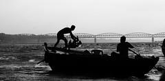 boatmen (fedvnd) Tags: travel bridge sea india man silhouette boat profile varanasi ganje motherganga