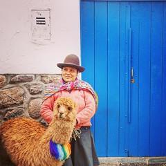 Peruvian woman & Lama (saadia_khans) Tags: cuscocity peru travelphotography travel streets streetphotography street blue door color woman peruvian lama cusco instagramapp square squareformat iphoneography mayfair