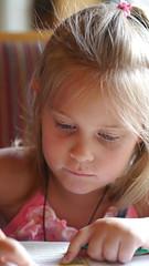 kindergartener playing with words (XTaki) Tags: girl writing words kid play olympus panasonic f18 45mm kindegarten gx1
