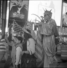 Liberty (thereisnocat) Tags: newyorkcity ny newyork night rolleiflex manhattan timessquare rodinal delta3200 crowded 7thavenue rolleiflexmxevs