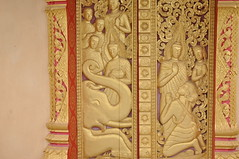 Elaborate carvings on the door (oldandsolo) Tags: sculpture southeastasia buddhism lp laos wat buddhisttemple luangprabang basrelief chedi buddhistart buddhistshrine laopdr unescoworldheritagecity buddhistreligion decorativedoor buddhistfaith phrathatkhongsantichedi