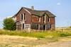 Tin Covered House (nikons4me) Tags: old roof house building abandoned overgrown southdakota tin weeds decay ghost siding decaying tallgrass okaton nikonafsdxnikkor35mmf18g nikond7100