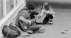 Dog busker (pootlepod) Tags: street blackandwhite music dog monochrome child guitar streetphotography busker begging collecting stphotographia